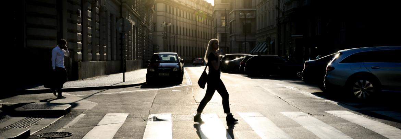 Pedestrian crossing the street in a crosswalk.
